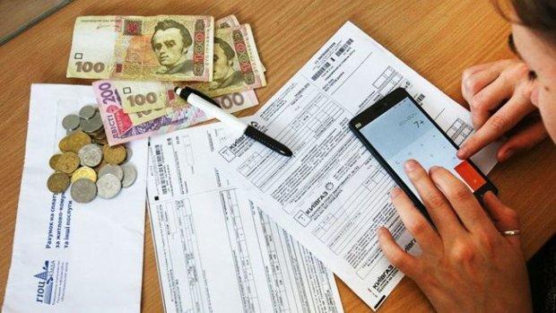 Заберут ползарплаты или квартиру: чем угрожают за долги по коммуналке?